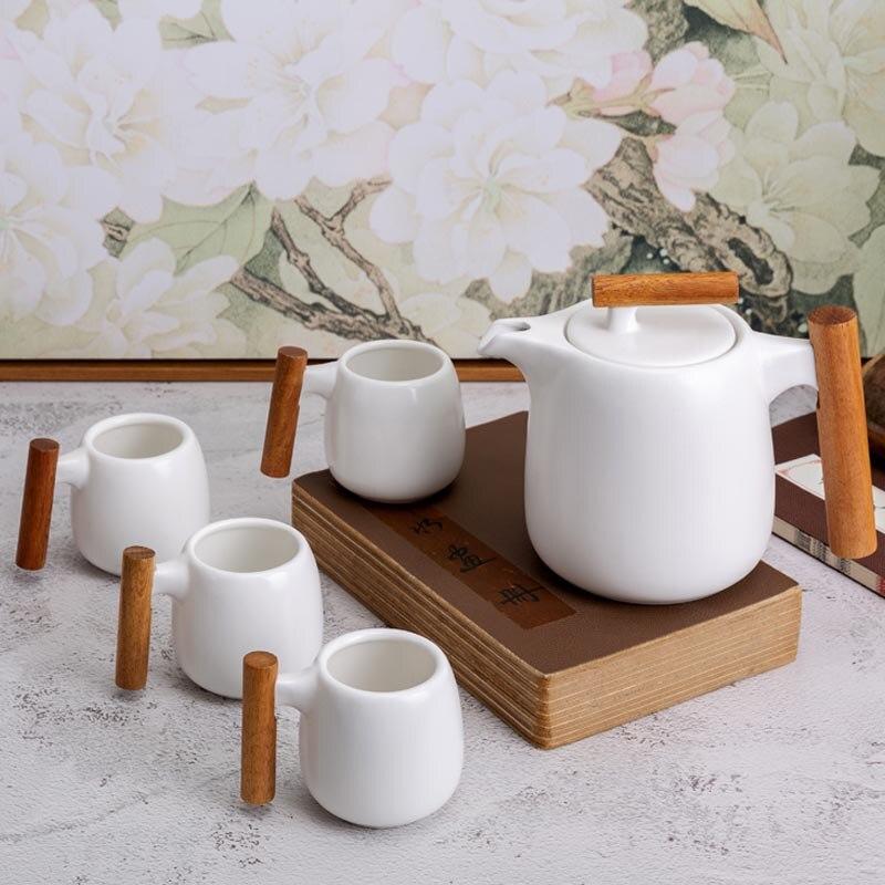 Ensemble de thé de Style chinois en céramique porcelaine café vaisselle boisson boisson bouilloire fleur théière lait tasse poignée thé décor