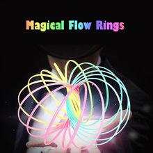 62e8c0a41413 2018 Flujo de anillos de plástico juguetes sensoriales cinética pulsera  primavera interactivo juguete genial de los niños adulto.