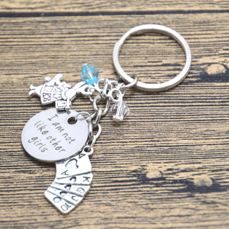 12pcs/lot Alice in Wonderland Inspired keyring I am not like other girls Silver tone crystals