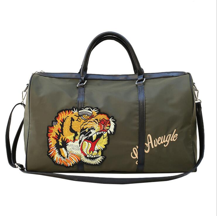 2018 Luxury Brand Style women men duffle bag Famous designer tiger head embroidery big travel bags woman luggage bag men bag