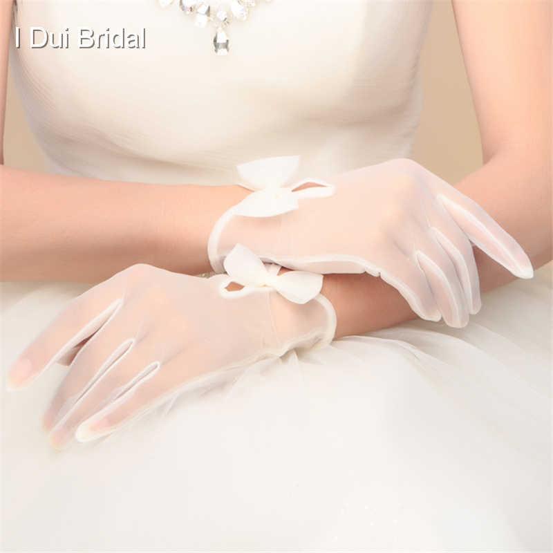 Короткие простые свадебные женские перчатки с бантом белого цвета слоновой кости дешевые высокого качества Тюль Иллюзия длина запястья имеют палец новый стиль