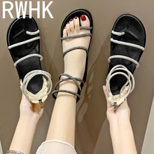 цены RWHK Roman sandals female summer 2019 new rhinestone straps Korean version of the flat toe student beach shoes B125