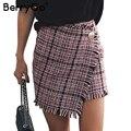 BerryGo Sexy asymmetrical plaid skirts women Elegant tassels high waist skirt Cool streetwear woolen short skirt 2017