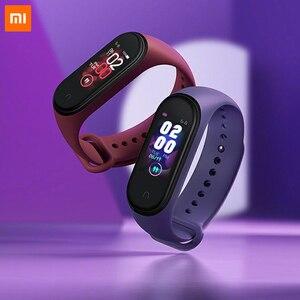 Image 1 - Xiao mi originale Mi banda intelligente 4 Wristband amoled 2.5D 0.95 POLLICI a colori dello Schermo 5ATM Bluetooth 5.0 Sensore della Frequenza cardiaca mi Braccialetto della fascia