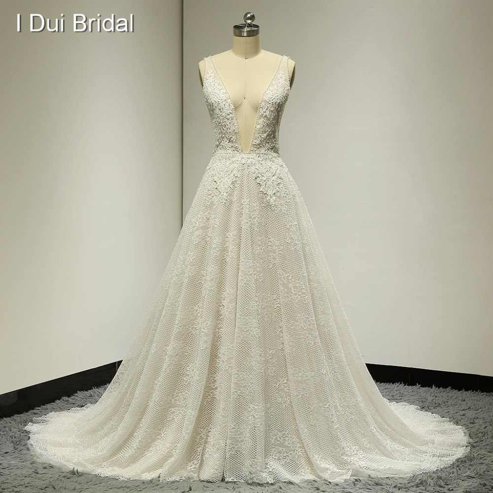 Sexy Boho Wedding Dresses Deep Neckline Low Back Pearl Crystal Beaded Lace Bridal Gown Factory Custom Made Real Photo