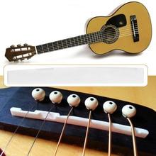 цена на Classical Buffalo Bone Guitar Bridge Saddle Replacement Parts For 6 String Acoustic Guitar Wholesale