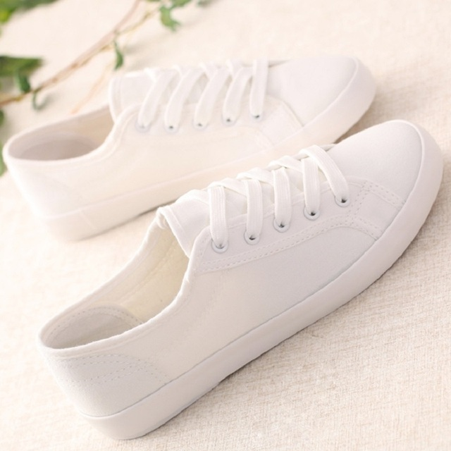 Classic Women Sneakers White Canvas Shoes Ladies Solid Casual Shoes Female  Flat Trainers vulcanize Basket Femme tenis feminino-in Women s Vulcanize  Shoes ... 1d0121c3d733