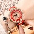 Женские кварцевые часы с разноцветными неровными бриллиантами и кожаным ремешком