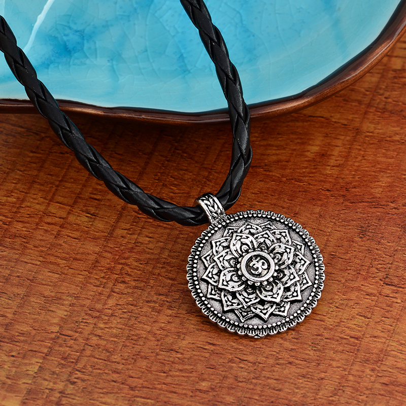 lotus with ohm inside, a metal pendant