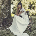 Bohemian Wedding Dresses 2016 Long Beach V Neck Illusion Lace Capped Sleeves A-line Open Back Floor-length Bridal Gowns