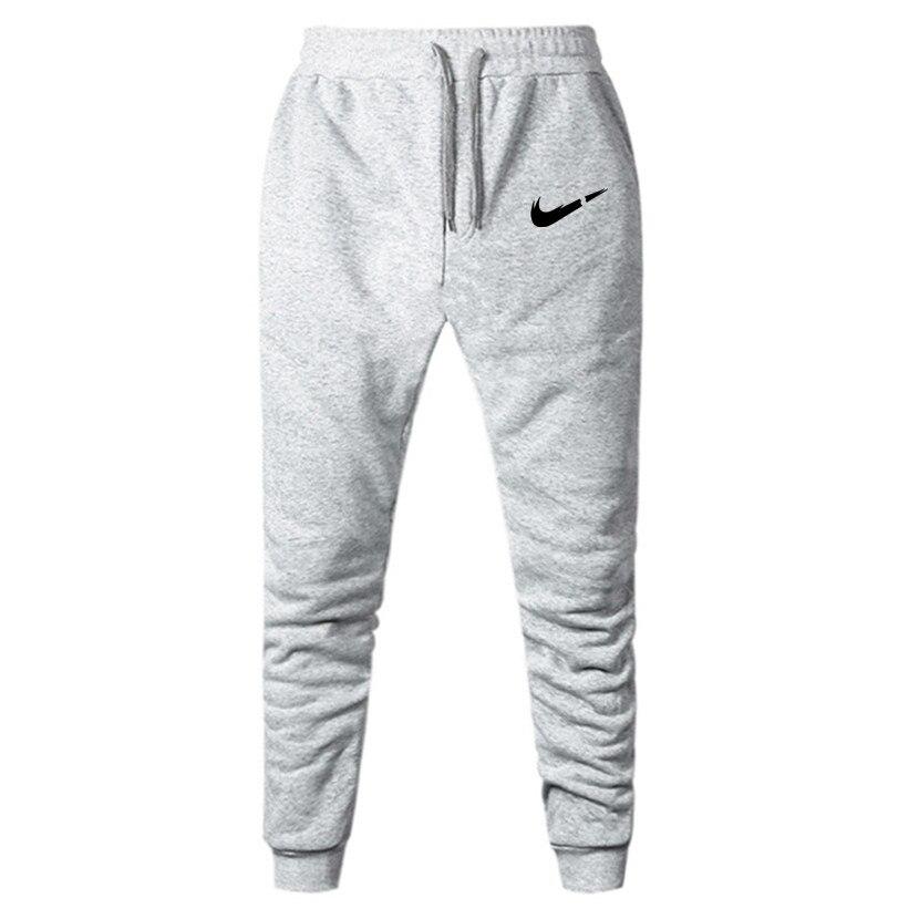 2019 nouveaux hommes survêtement s marque hommes pantalons pantalons décontractés pantalons de survêtement gris décontracté élastique coton gymnases Fitness entraînement Dar XXXL