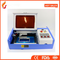 3020 co2 laser engraving machines laser cutting machines for rexine plywood , acrylic , rubber stamp , cloth , felt