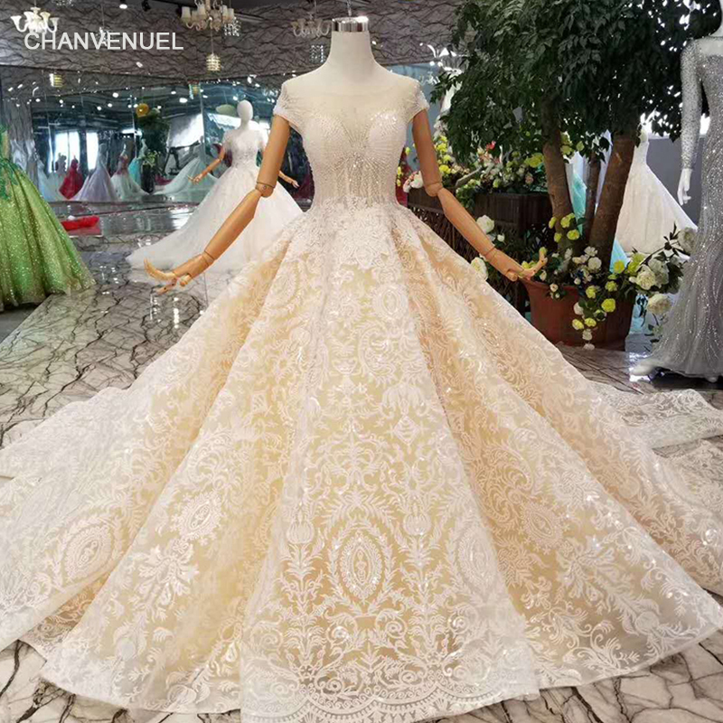 LSS120 luxury lace wedding dress appliques transparent o-neck short sleeves  lace up shiny wedding gown with train latest design 3e226cfde4cc