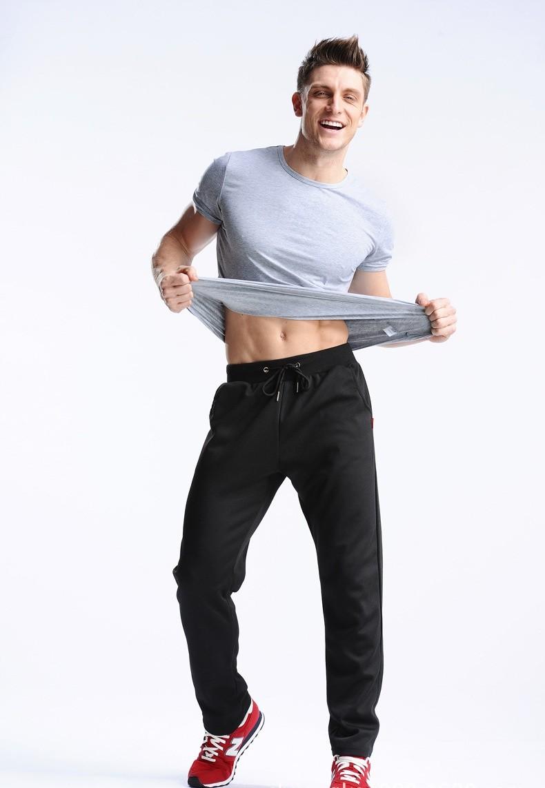 Uwback 17 Plus Size 4XL New Sweat Pants Men Joggers Pants Elastic Waist Loose Sweat Pants For Men Casual Trousers homme CAA329 15