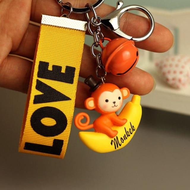 1 Cái Đáng Yêu Nhựa Con Khỉ Cưỡi Chuối Hành Động Hình PVC KeyChain Holder màu sắc Ngẫu Nhiên