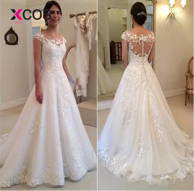 XCOS Vestido de Noiva Modest Sheer Bateau Neckline See Through Button Back Wedding Dress 2018 New Cap Sleeves Bridal Gown
