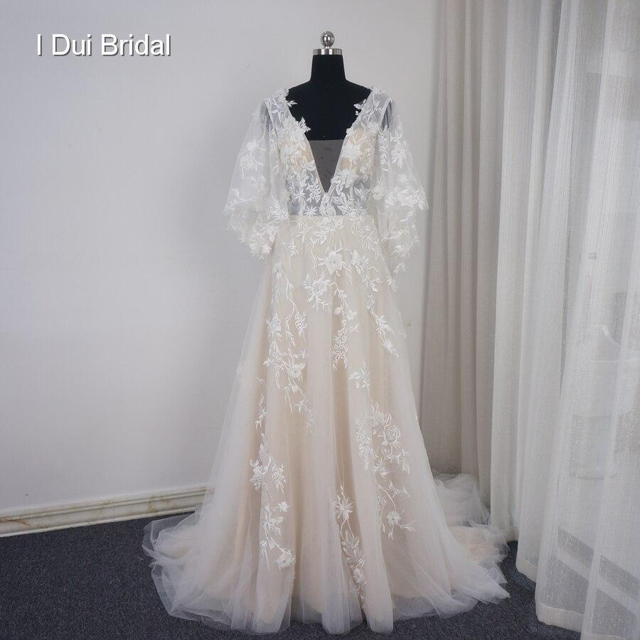 64e6eb6c75875 Robe de mariée florale col en V une ligne avec manches évasées sur mesure