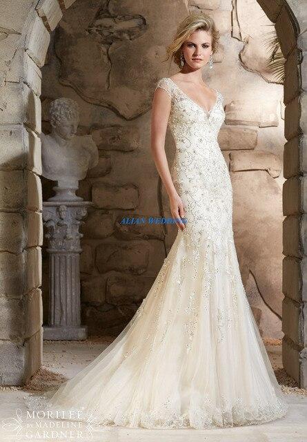 Us 205 86 Wedding Dress Patterns Short Sleeve Vestidos De Novia Delicate Beaded Bridal Gowns Appliques Organza Low Back In Stock Nw3527 In Wedding