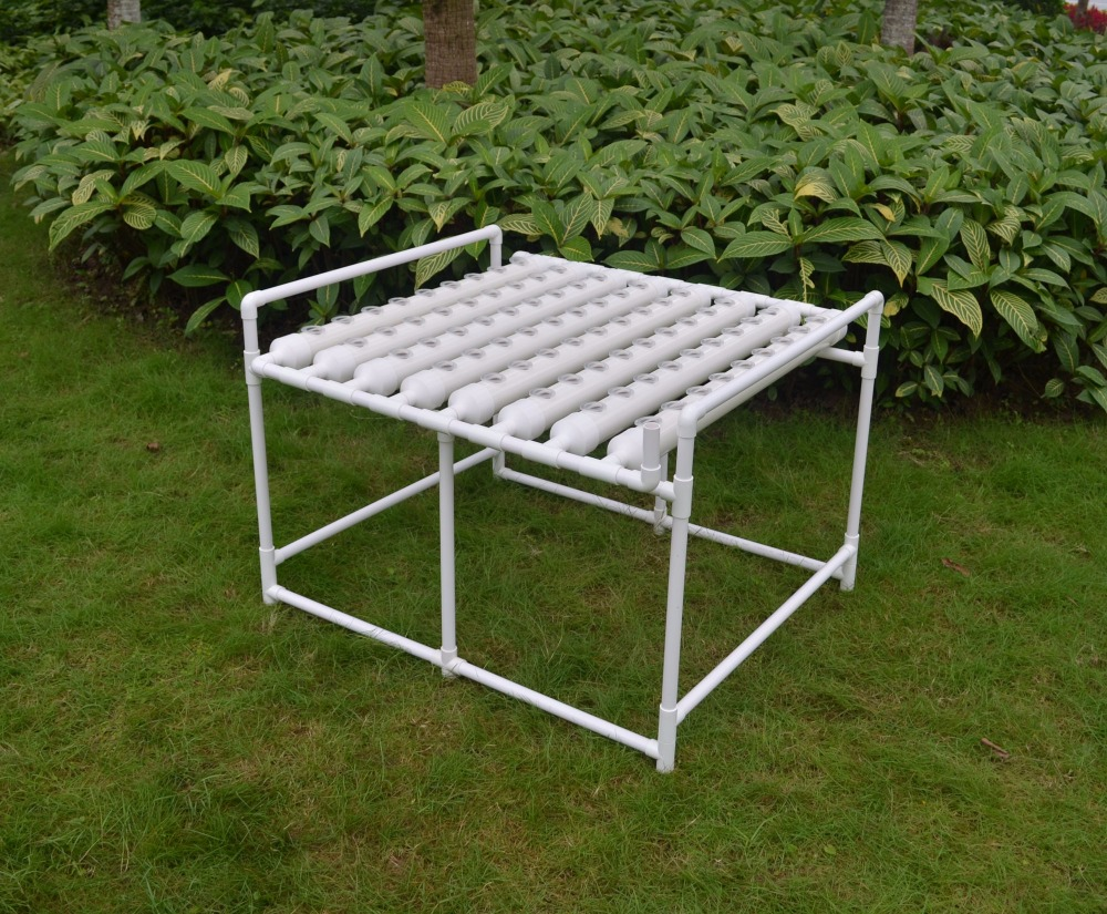 DIY Hydroponics system NFT with 72pcs of net cup. Nutrient Film Technique (NFT) PVC pipe plant pot plant nursery pot image