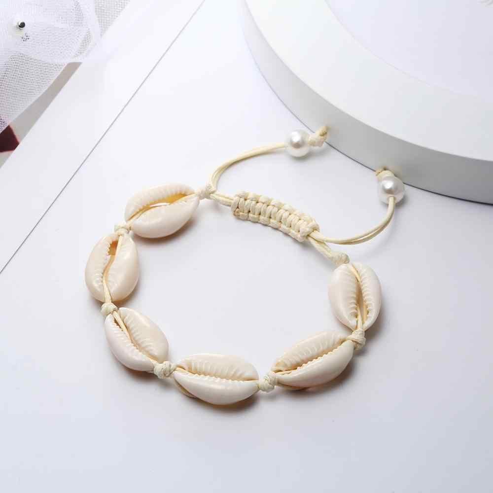 โบฮีเมีย Handmade ผู้หญิงสร้อยข้อมือธรรมชาติ Cowrie Sea Shell ถักสร้อยข้อมือเชือกปรับที่ละเอียดอ่อนเครื่องประดับของขวัญ