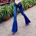 Europa Estilo de la Estrella Sexy Cintura Baja Big Acampanados Pantalones Vaqueros de La Señora moda Campana de Corte Para Botas Pantalones de Mezclilla de Fondo Delgada Flash Borla pantalones vaqueros