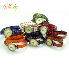 shsby New fashion trend in female table personality retro manual real cowhide women dress watch leather strap rivet watches