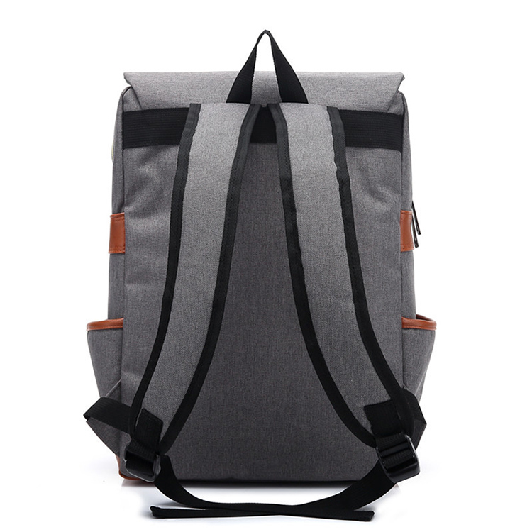 the backside of a grey backpack