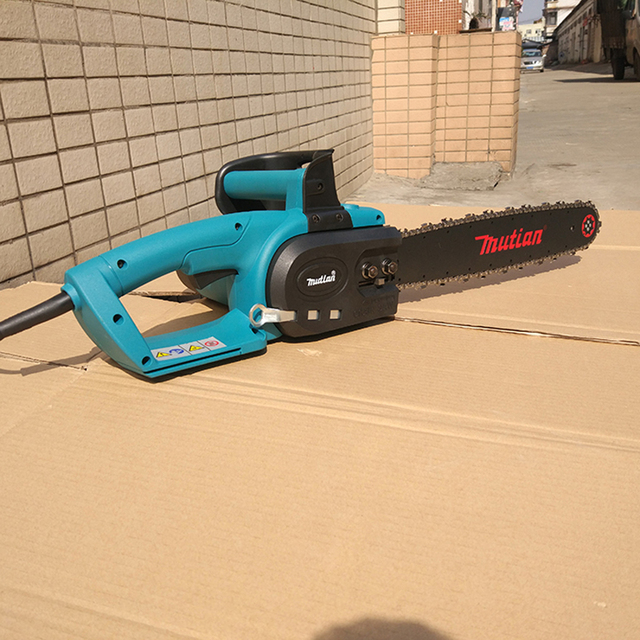 The newest genuine makita mt 7018b electric chain saws 2800w the newest genuine makita mt 7018b electric chain saws 2800w chainsaw 16 inch logging greentooth Choice Image