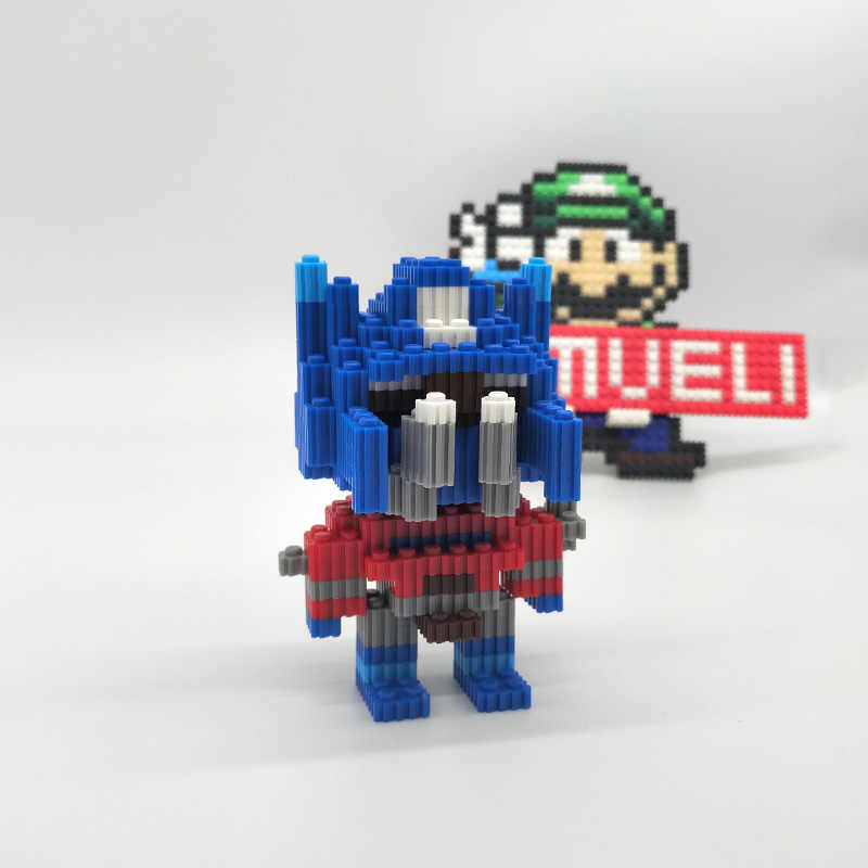MUMUELI Transformers Optimus Prime 1000-1500 ชิ้น DIY อะนิเมะ 3D ชุดบล็อกเด็กจิ๊กซอว์อาคารเด็กของเล่น KL-QTZ