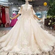 LSS402 robes de mariée de train détachables avec grand noeud spaghetti bretelles robe de mariée avec train amovible retour