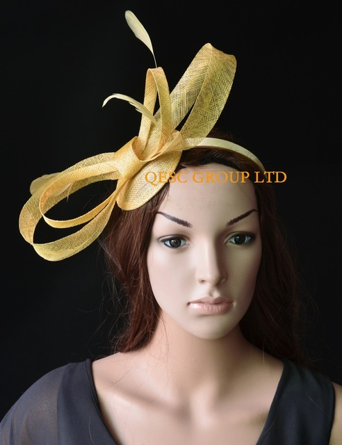 719d5cfef162a Champagne gold sinamay fascinator with big sinamay bow feathers for Tea  Garden party Royal Races Kentucky derby.