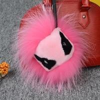 Trendy bont wasbeer monster anime sleutelhanger leuke solid roze zwart dier pom pom charm voor vrouwen tas hanger ronde pluizige haarbal