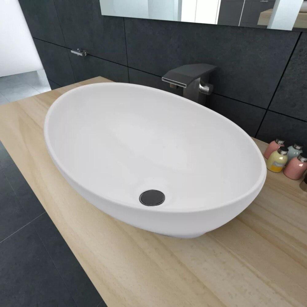 Comptoir d'évier de style moderne lavabo artistique de haute qualité de forme ovale lavabo de luxe en céramique lavabo de salle de bains