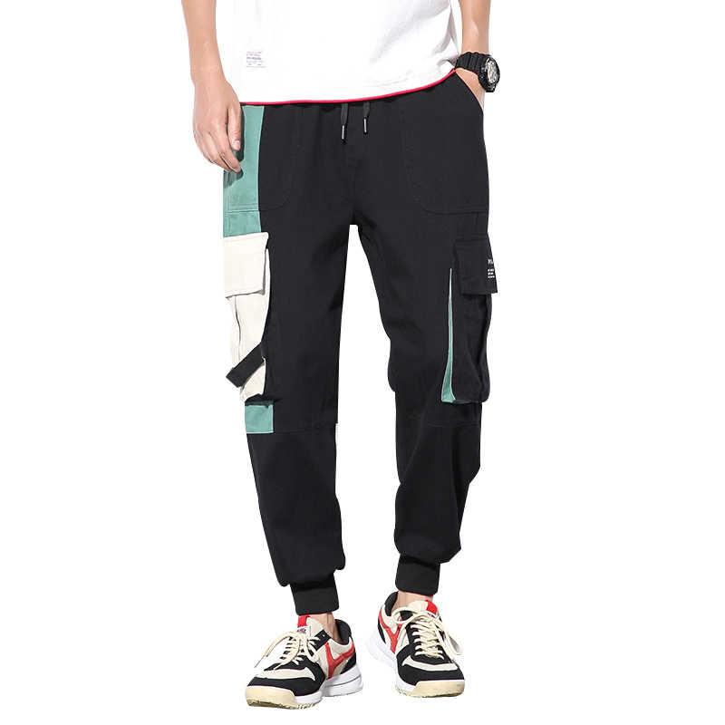 2019 nowy jesień mężczyźni Strretwear spodnie Cargo szwy kolor biegaczy Hip Hop spodnie męskie elastyczny pas spodnie męskie ABZ406