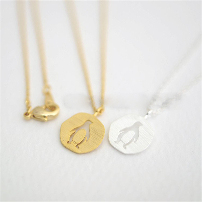 Fashion penguin necklaces Beautiful circular hollow out penguin ...