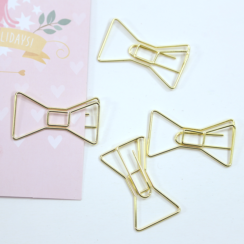 Купить с кэшбэком 4PCS/LOT Electroplated Gold Paper Clips Pin Metal Clip Bookmarks Storage Office Accessories Cute Bow Paper clips H0060