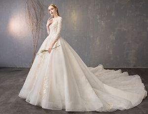 Image 3 - Walk Beside You Champagne Wedding Dresses Lace Applique Beaded Ball Gown Cathedral Train Three Quarter Sleeves Bridal Gowns Long