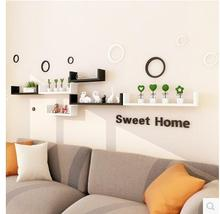 The wall shelf sitting room hanging partition is put aside multi-layer shelves from punching contracted and contempo