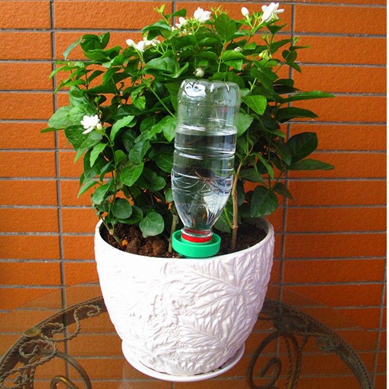 157732a4c3c60 Menor Preço 2 PCS Planta Flor Cerâmica Garrafa de Água de Irrigação Por  Gotejamento Jardim Automático de Rega de Irrigação Pico CANDYKEE