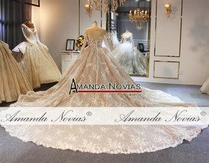Image 2 - فستان زفاف بلون الشمبانيا مع قطار طويل فاخر وزهور ثلاثية الأبعاد