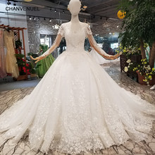 726c0b23698d7 LSS121 newest tassel long sleeve wedding dress appliques o-neck sexy v-back  shiny beauty wedding gown with train free shipping