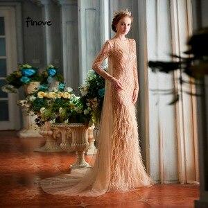 Image 1 - Finove vestidos de noche para mujer, novedad de 2020, elegantes vestidos de sirena champán de lujo con plumas y abalorios, longitud hasta el suelo, vestidos de fiesta para mujer