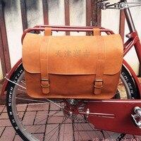 Spor ve Eğlence'ten Bisiklet Çantaları ve Sepetleri'de E0987 Ücretsiz kargo Retro Pratik % 100% sığır derisi Bisiklet Arka raf çantası Süper büyük bisiklet Gidon asmak sırt çantası