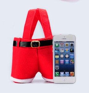 Image 1 - 10 adet Mutlu noel hediyesi Tedavi Şeker şarap şişesi Çantası Noel Baba Askı Pantolon Pantolon Dekor noel hediyesi Çanta