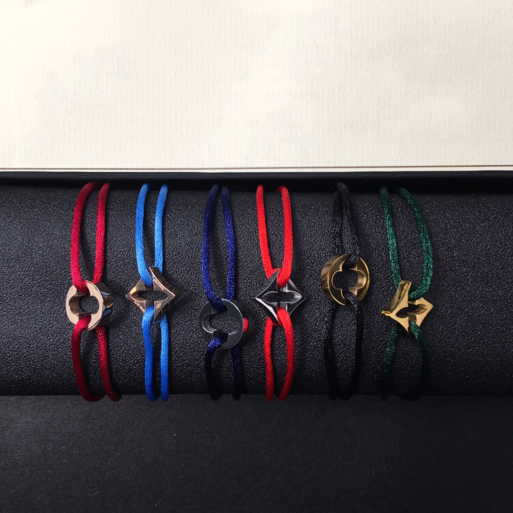 Hot sell Beautifully sold titanium steel hollowed cross flower four leaf clover rhombus hand rope bracelet fashion lover jewelry