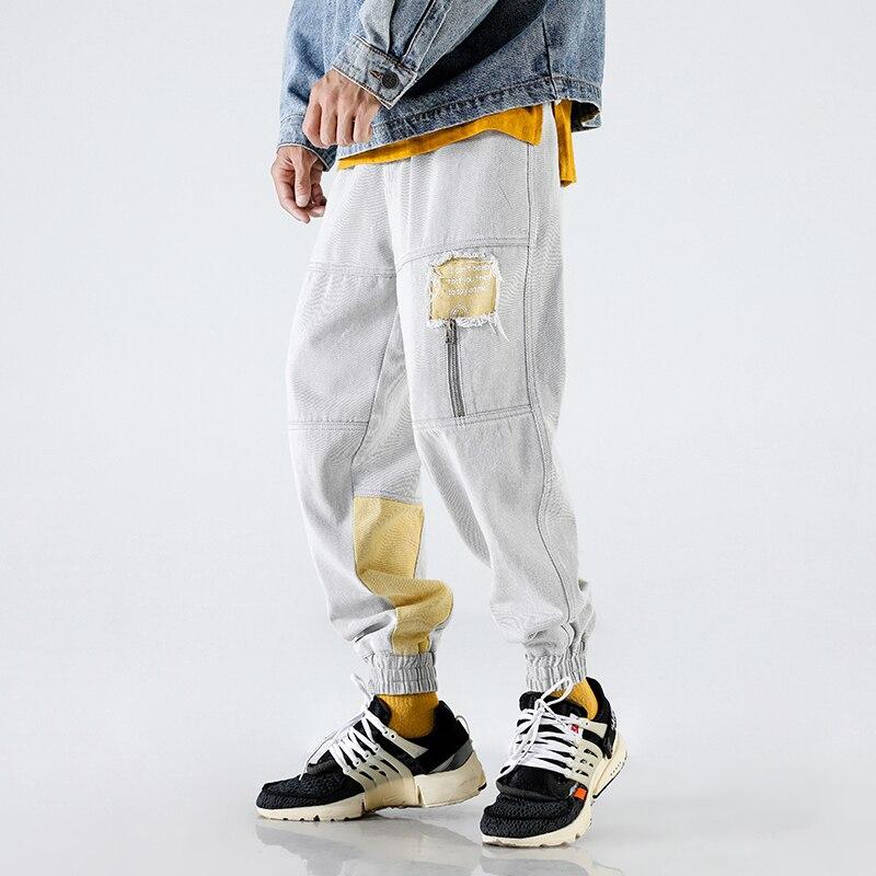 100% QualitäT Männer Mode Hip-hop Hot Lose Streetwear Herbst Kleidung Neue Muster Löcher Kennzeichnung Persönlichkeit Freizeit Zeit Hose Nichts