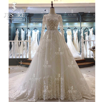 Illusion Bodice Long Sleeves A line Pearls Beading Appliques Open Low Back Jewel Neckline Classic Lace Hem Wedding Dress 2018