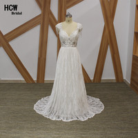 Romantic Boho Wedding Dress Exquisite Beaded Lace Beach Bridal Gowns Backless V Neck Floor Length Vintage