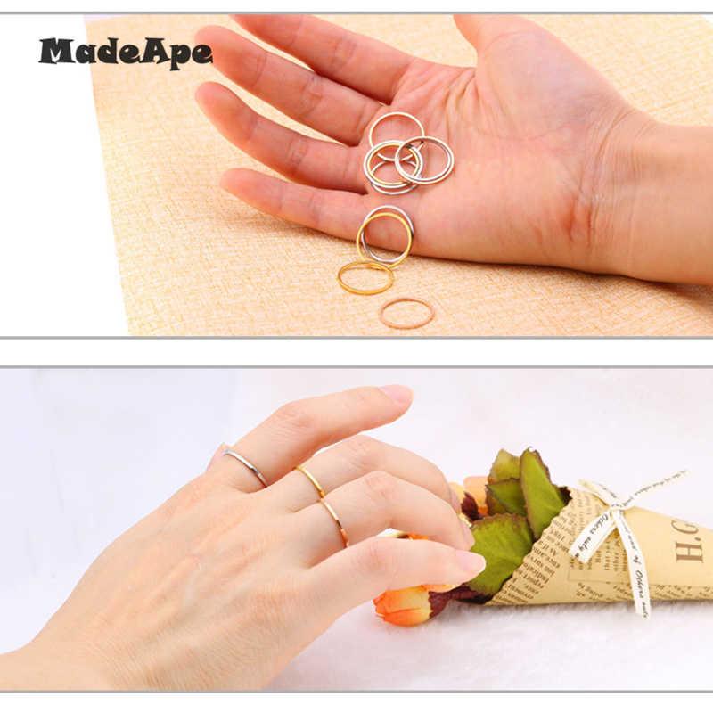 MadApe 1 มม. ไทเทเนียมสแตนเลสสตีล Rose Gold Anti - allergy Smooth คู่แต่งงานแหวนผู้หญิงแฟชั่นผู้ชายเครื่องประดับ
