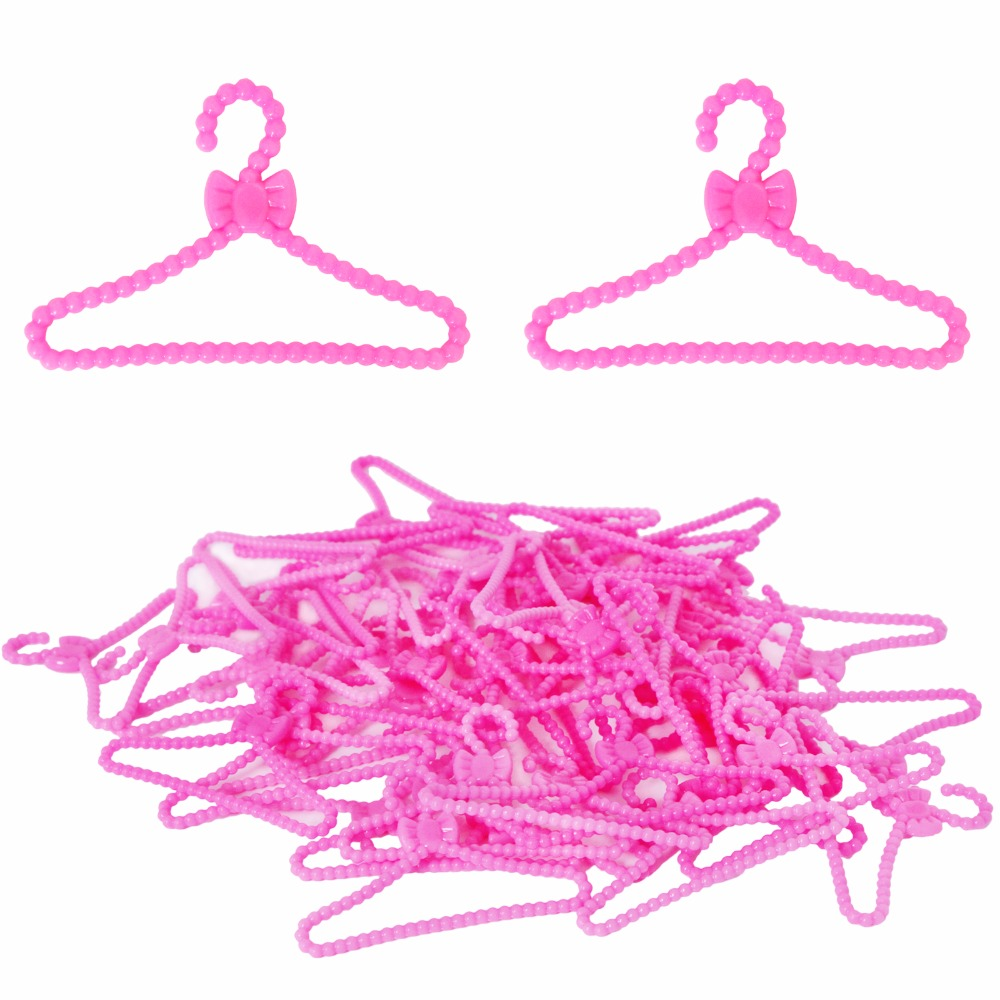 20 Pcs / Lot Mini Doll Accessories Pink Plastic Bowknot Hangers For Barbie Doll Clothes Dress Pretend Play House Baby Toy